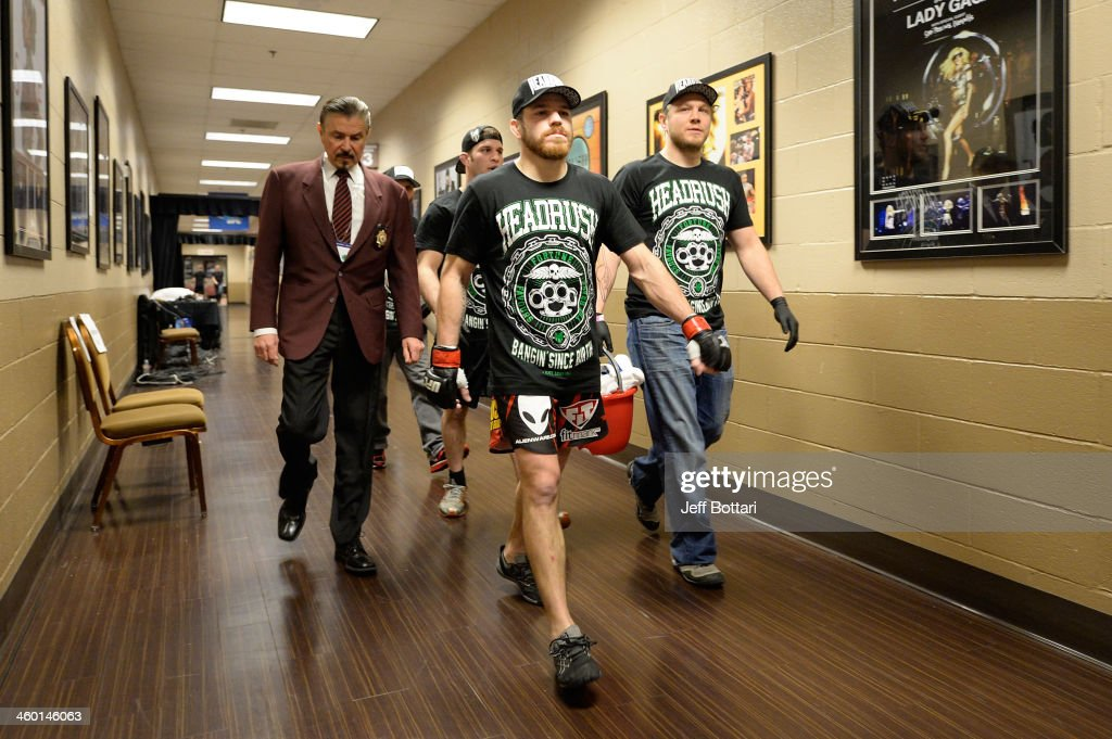Jim Miller walks out of the locker room before facing Fabricio Camoes in their lightweight bout during the UFC 168 event at the MGM Grand Garden Arena on December 28, 2013 in Las Vegas, Nevada.