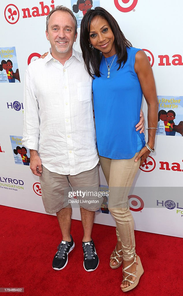 Jim Mitchell (L) and actress <a gi-track='captionPersonalityLinkClicked' href=/galleries/search?phrase=Holly+Robinson+Peete&family=editorial&specificpeople=213716 ng-click='$event.stopPropagation()'>Holly Robinson Peete</a> attend the HollyRod Foundation's 4th Annual My Brother Charlie Carnival at Culver Studios on August 3, 2013 in Culver City, California.