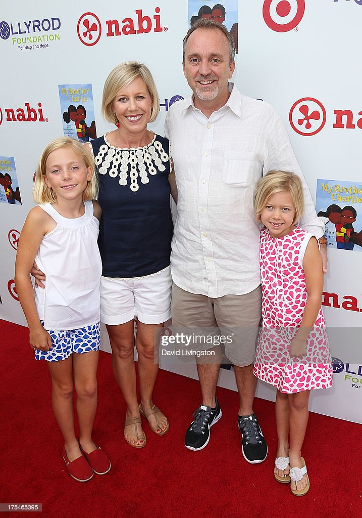 Jim Mitchell and family attend the HollyRod Foundation's 4th Annual My Brother Charlie Carnival at Culver Studios on August 3, 2013 in Culver City, California.