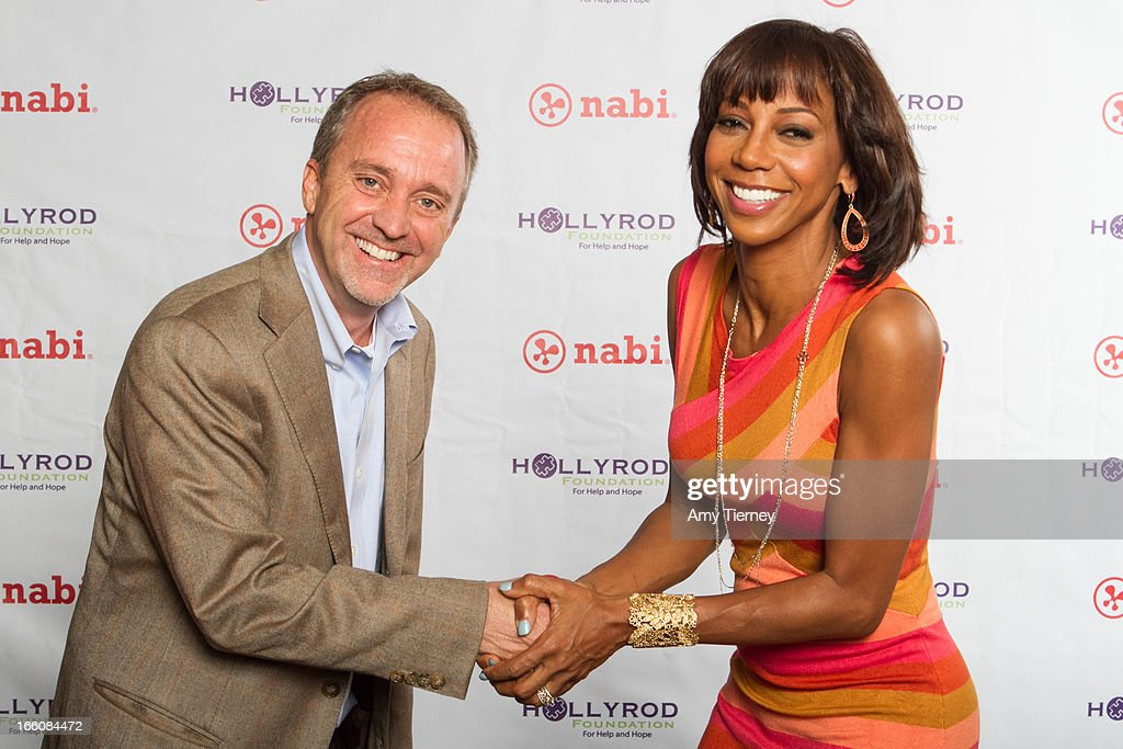 Jim Mitchell, CEO, Fuhu Inc., and Holly Robinsn Peete gather for a donation on behalf of nabi to the HollyRod Foundation to help families living with autism at Fuhu, Inc. on April 7, 2013 in Los Angeles, California.