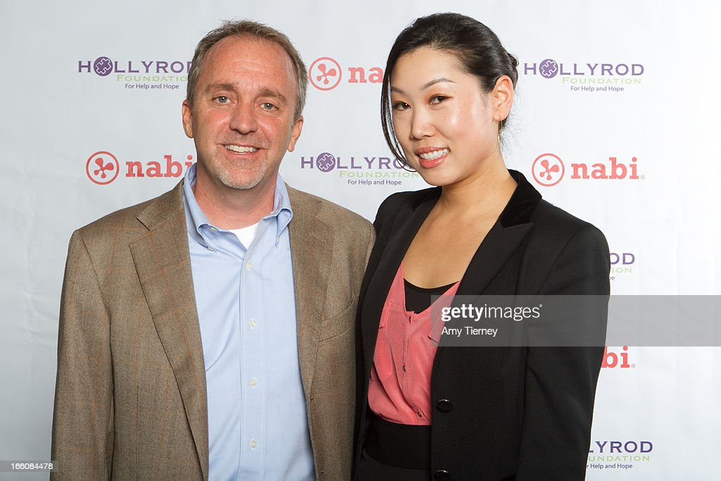 Jim Mitchell, CEO, Fuhu Inc., and Lisa Lee, Director of Marketing and Communications, Fuhu Inc., gather for a donation on behalf of nabi to the HollyRod Foundation to help families living with autism at Fuhu, Inc. on April 7, 2013 in Los Angeles, California.