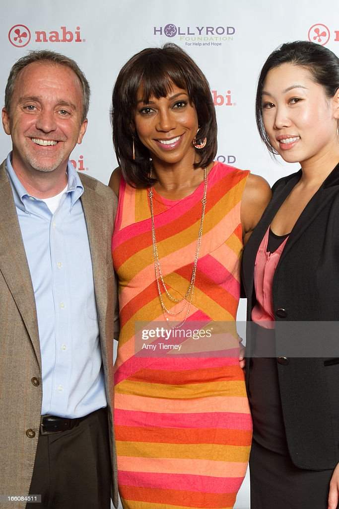 Jim Mitchell, CEO, Fuhu Inc., Holly Robinson Peete, and Lisa Lee, Director of Marketing and Communications, Fuhu Inc., gather for a donation on behalf of nabi to the HollyRod Foundation to help families living with autism at Fuhu, Inc. on April 7, 2013 in Los Angeles, California.