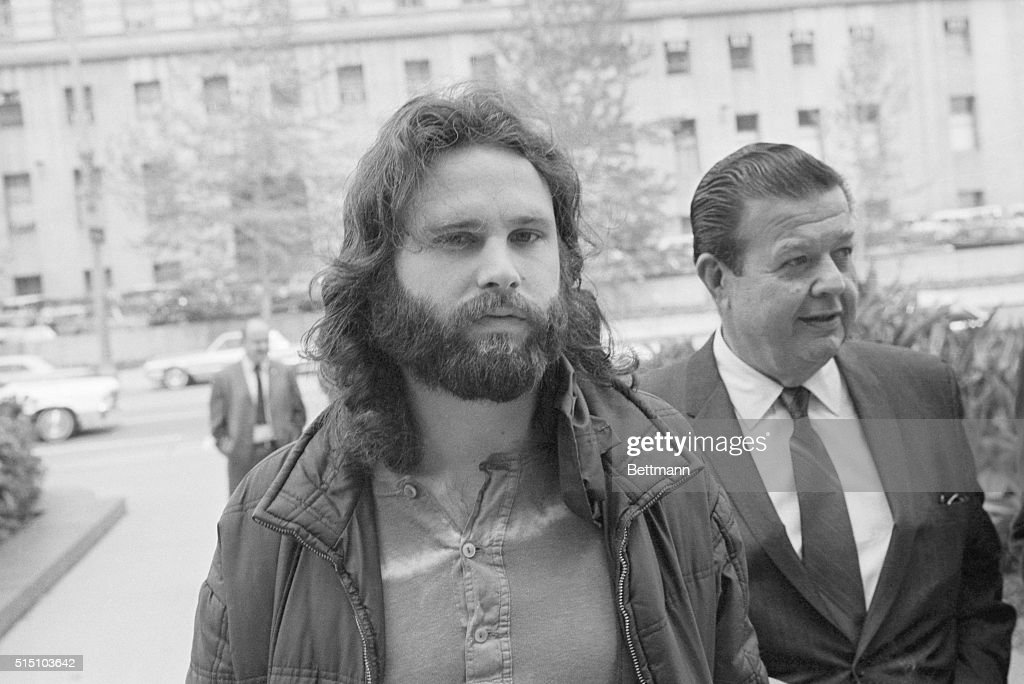 <a gi-track='captionPersonalityLinkClicked' href=/galleries/search?phrase=Jim+Morrison&family=editorial&specificpeople=200754 ng-click='$event.stopPropagation()'>Jim Morrison</a> (L), lead singer of the rock group 'The Doors' is accompanied by his attorney Max Fink as he arrives at the Los Angeles Federal Building to appear before the U.S. Commissioner for extradition proceedings to Florida. Morrison, according to the FBI, was wanted on six charges, including lewd and lascivious behavior, while performing before some 12,000 persons, mostly teen-agers. The FBI said they entered the case 3/27 when a federal warrant charging interstate flight to avoid prosecution was issued in Miami.