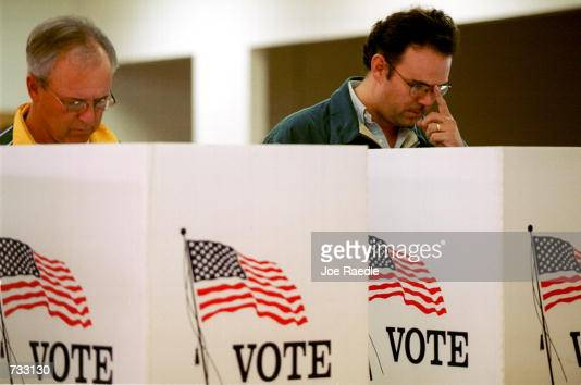 Jim Morrow and Jorge Fitzmaurice cast their ballot for president of the United States in early voting in El Paso Texas October 23 2000 The state of...