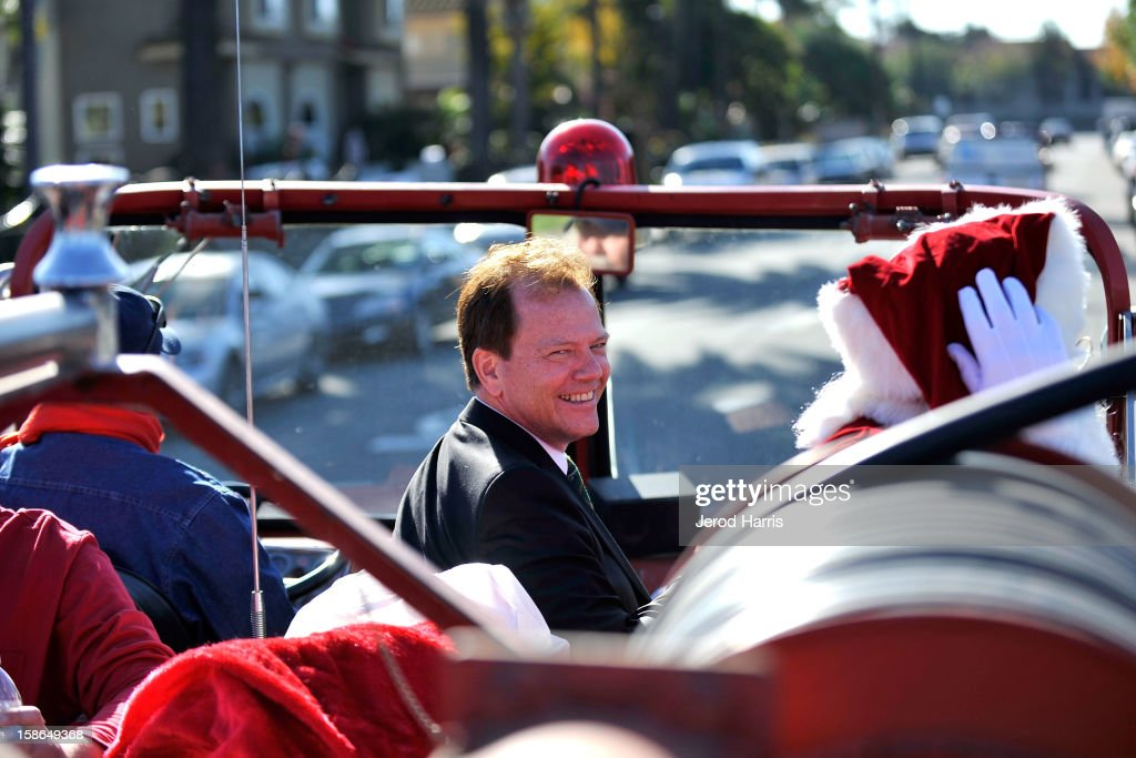 Jim Murphy, GM of Bloomingdales South Coast Plaza, rides in a fire truck with Santa delivering gifts to underpriviledged families for the 12th Annual CMFD Santa Letters on December 22, 2012 in Costa Mesa, California.