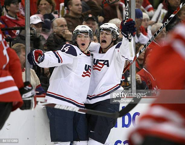 Jim O Brien of Team USA celebrates his goal with teammate Mitch Wahl in action against Team Canada during the IIHF World Junior Championships held at...