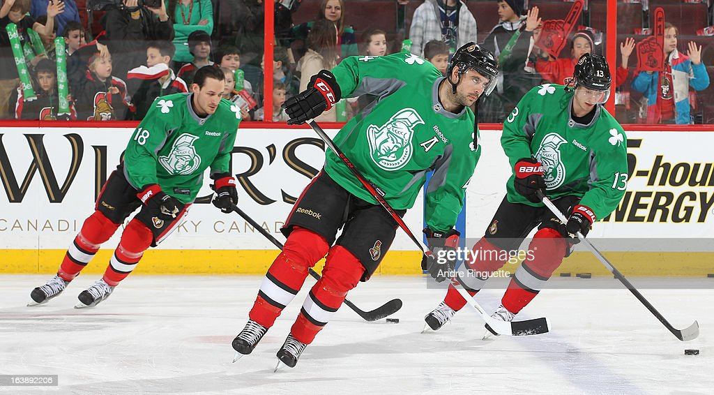 Jim O'Brien #18, Chris Phillips #4 and Peter Regin #13 of the Ottawa Senators warm up prior to a game against the Winnipeg Jets wearing special green jerseys for St. Patrick's Day on March 17, 2013 at Scotiabank Place in Ottawa, Ontario, Canada.