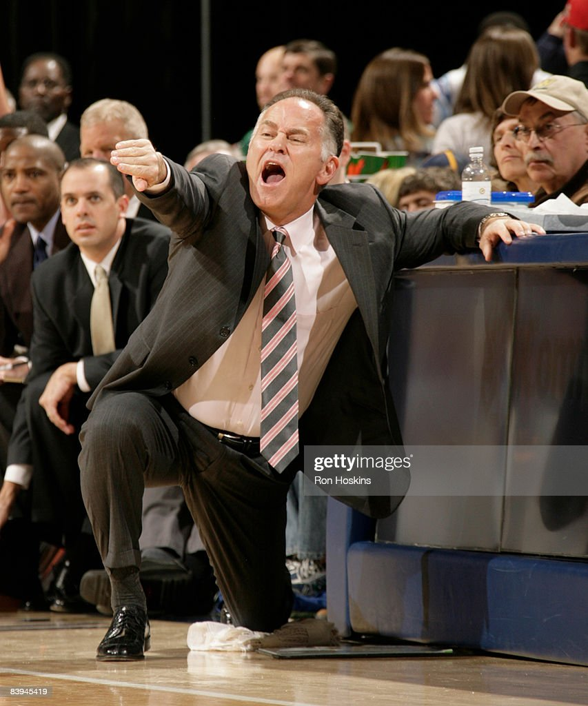 Jim O'Brien head coach of the Indiana Pacers directs his team from the sidelines during the game between the Pacers and the Boston Celtics at Conseco...