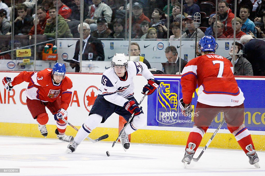 Jim O'Brien of Team USA skates with the puck while being chased by Radko Gudas during the IIHF World Junior Championships at Scotiabank Place on...