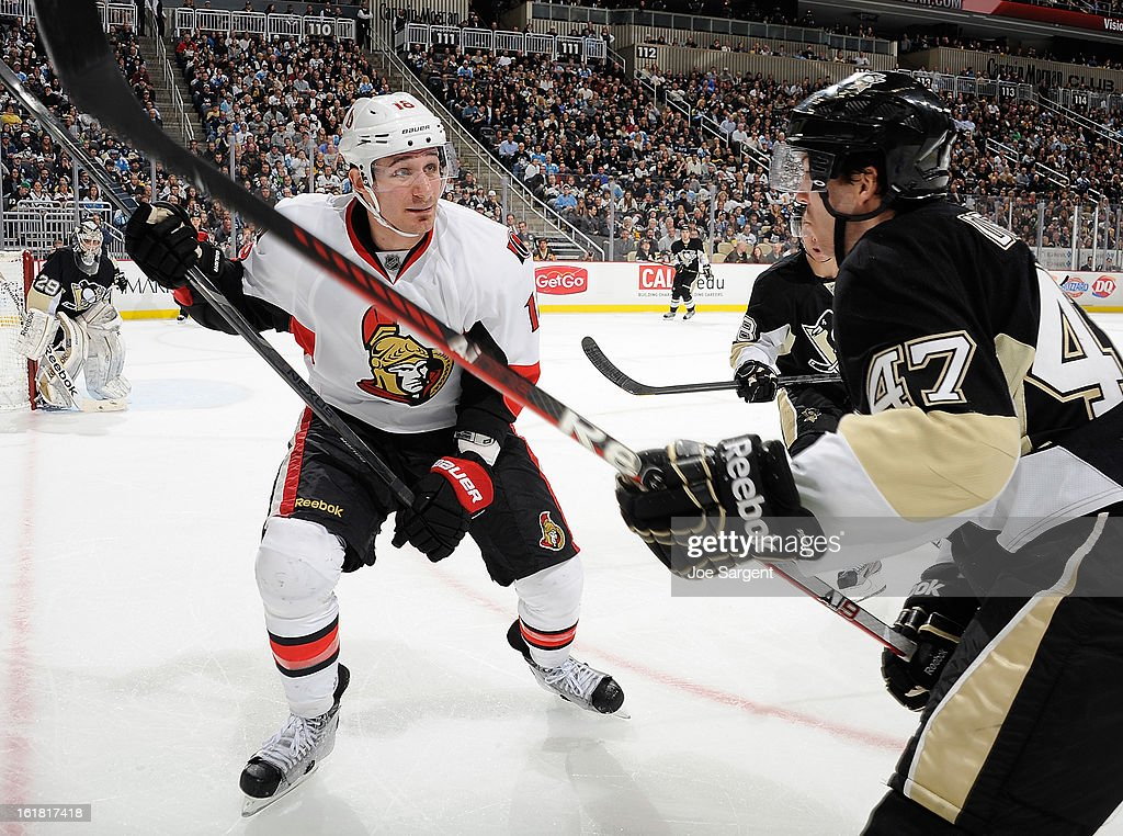 Jim O'Brien #18 of the Ottawa Senators battles for position against <a gi-track='captionPersonalityLinkClicked' href=/galleries/search?phrase=Simon+Despres&family=editorial&specificpeople=4649466 ng-click='$event.stopPropagation()'>Simon Despres</a> #47 of the Pittsburgh Penguins on February 13, 2013 at Consol Energy Center in Pittsburgh, Pennsylvania.