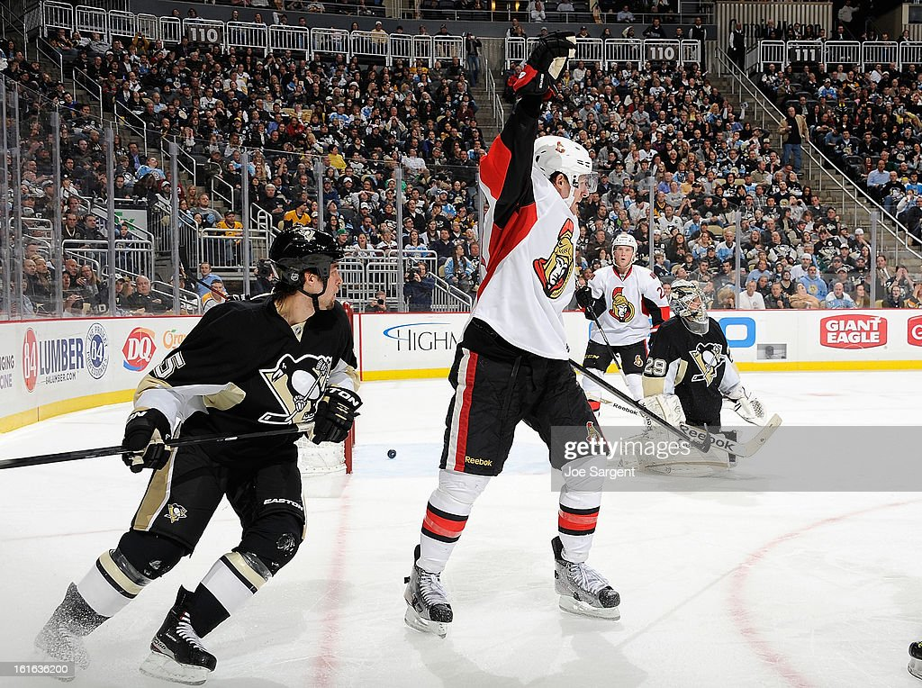 Jim O'Brien #18 of the Ottawa Senators celebrates his goal in front of Deryk Engelland #5 of the Pittsburgh Penguins on February 13, 2013 at Consol Energy Center in Pittsburgh, Pennsylvania.