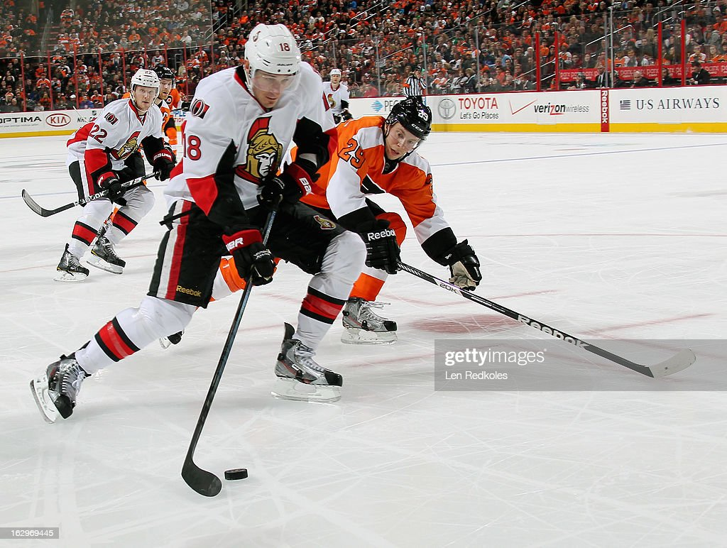 Jim O'Brien #18 of the Ottawa Senators controls the puck while being pursued by Erik Gustafsson #29 of the Philadelphia Flyers on March 2, 2013 at the Wells Fargo Center in Philadelphia, Pennsylvania. The Flyers went on to defeat the Senators 2-1.