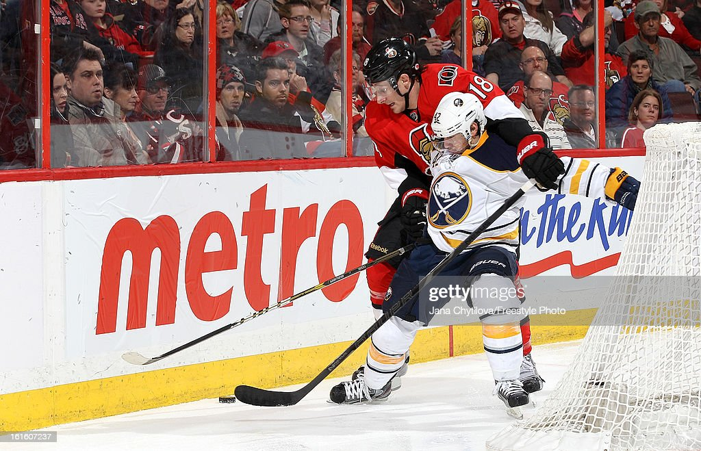 Jim O'Brien #18 of the Ottawa Senators gets called for holding as he defends against Nathan Gerbe #42 of the Buffalo Sabres during an NHL game at Scotiabank Place on February 12, 2013 in Ottawa, Ontario, Canada.