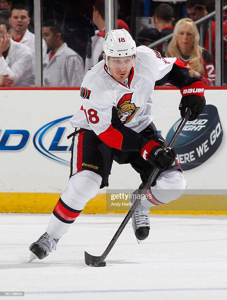 Jim O'Brien #18 of the Ottawa Senators plays the puck against the New Jersey Devils during the game at the Prudential Center on February 18, 2013 in Newark, New Jersey.