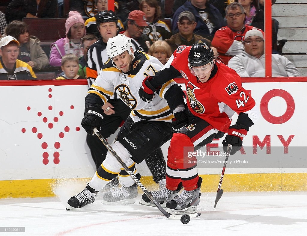 Jim O'Brien #42 of the Ottawa Senators tries to hold off <a gi-track='captionPersonalityLinkClicked' href=/galleries/search?phrase=Milan+Lucic&family=editorial&specificpeople=537957 ng-click='$event.stopPropagation()'>Milan Lucic</a> #17 of the Boston Bruins as they skate for the puck during an NHL game at Scotiabank Place on April 5, 2012 in Ottawa, Ontario, Canada.