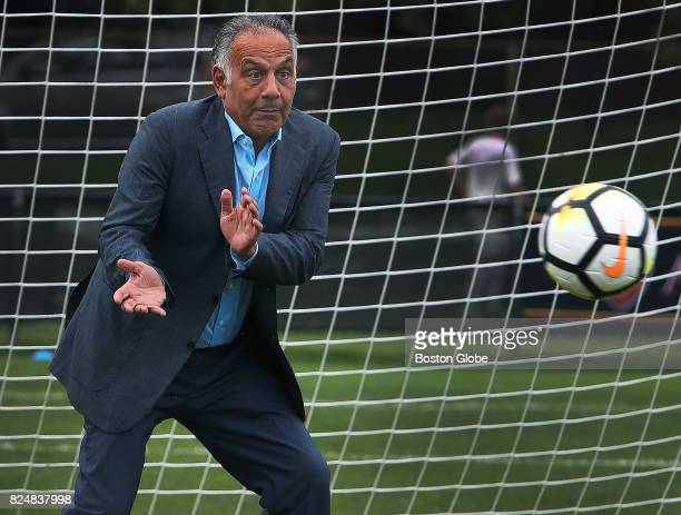 Jim Pallotta owner of AS Roma soccer team attempts to catch a ball a player fired at him before a team practice at the Ohiri Field in Cambridge Mass...