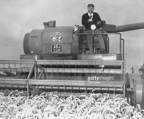 Jim Prior the Minister of Agriculture and Fisheries driving a combine harvester on his farm in Brampton Suffolk August 17th 1970