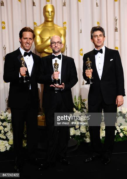 Jim Rash Nat Faxon and Alexander Payne with their awards for Best Adapted Screenplay received for The Descendants at the 84th Academy Awards at the...