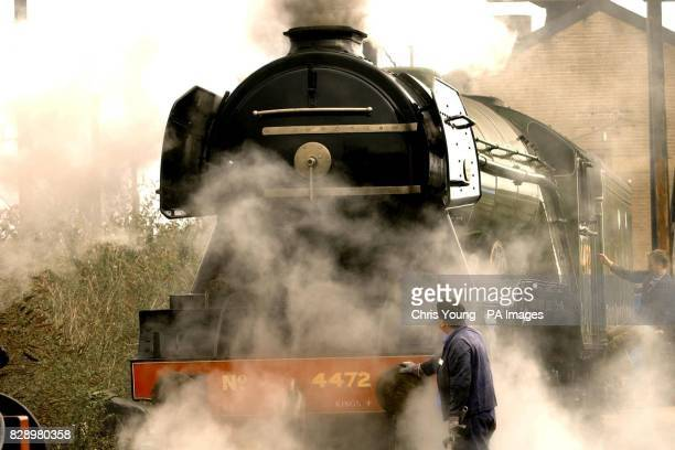 Jim Rees Vehicle Collections Manager inspects the Flying Scotsman one of the world's most famous locomotives running on Britain's railways pictured...