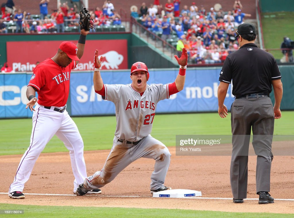 Jim Reynolds umpire calls Mike Trout of the Los Angeles Angels of Anaheim out in game one of the double header against Adrian Beltre of the Texas...