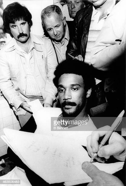 Jim Rice of the Boston Red Sox talks to reporters in the locker room after reaching the 400 total bases mark during the game against the Toronto Blue...