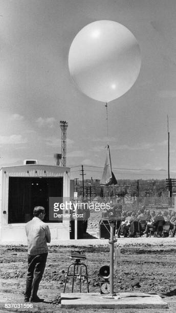 Jim Robinette meteorololgical technician awaits launch of balloon carrying radiosonde When conditions warrant data will be relayed to city and state...