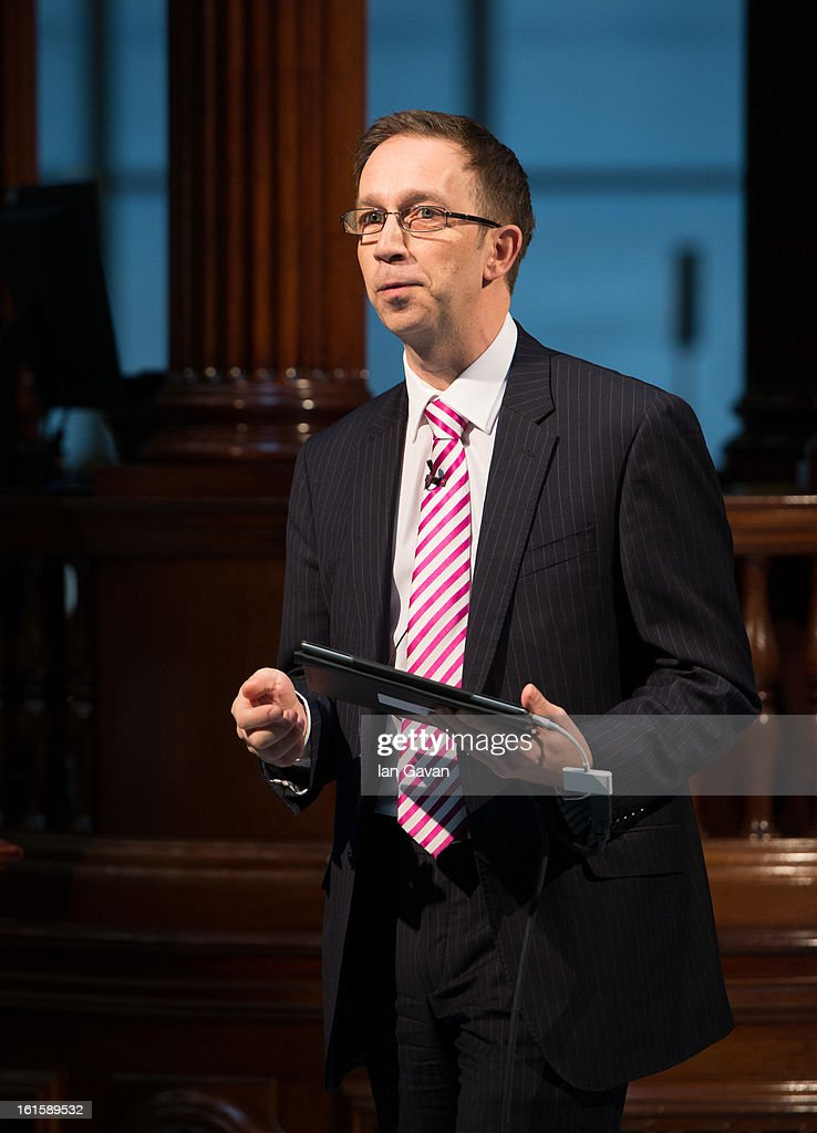 Jim Sadler of Xchanging demonstrates the new iPad application at Lloyd's of London on February 12, 2013 in London, England. The application allows those in the market to abandon the traditional broker's slipcase and work on tablets for the first time in the centuries old insurance market.