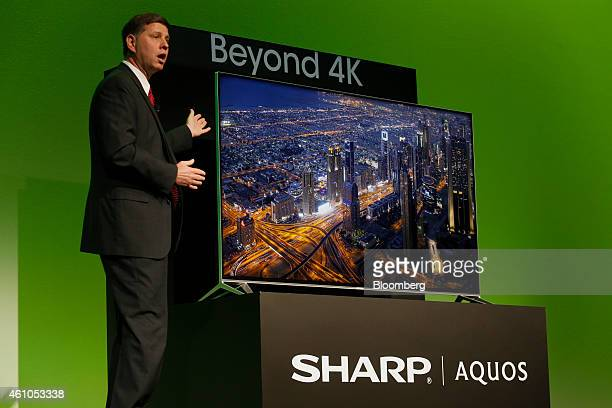 Jim Sanduski president of Sharp Electronics Marketing Corp of America reveals the Sharp Aquos Beyond 4k Ultra HD television during the 2015 Consumer...