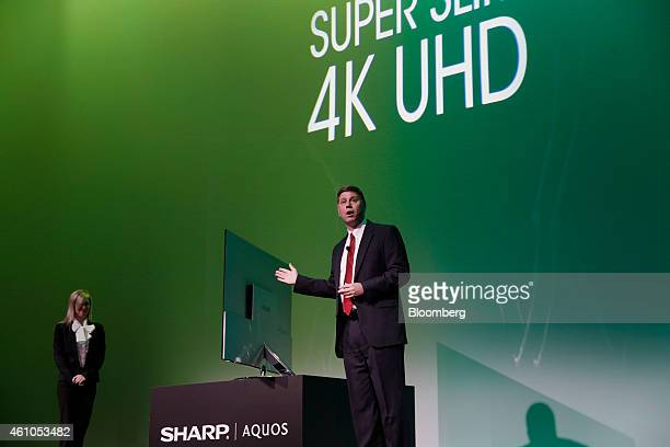 Jim Sanduski president of Sharp Electronics Marketing Corp of America reveals the Sharp Corp Super Slim 4k UHD television during the 2015 Consumer...