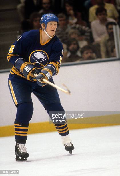 Jim Schoenfeld of the Buffalo Sabres passes the puck during the 1980 SemiFinals against the New York Islanders in May 1980 at the Nassau Coliseum in...