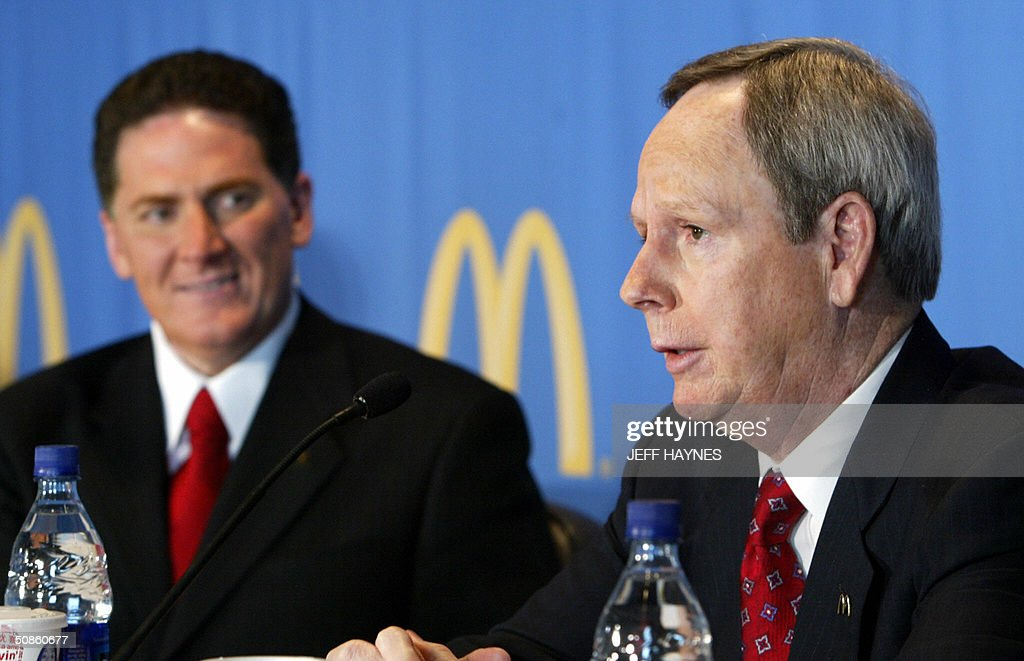 Jim Skinner(R), Vice Chairman McDonald's Corporation addresses the media as Charlie Bell, CEO looks on 20 May, 2004 after the 2004 Annual Shareholders meeting at the corporate headquarters in Oak Brook, IL. Bell took over the reins of Mcdonald's after CEO James Cantalupo died of a heart attack on 18 April, 2004. McDonald's stock is up about 50 percent since last years shareholders meeting. AFP PHOTO/Jeff HAYNES