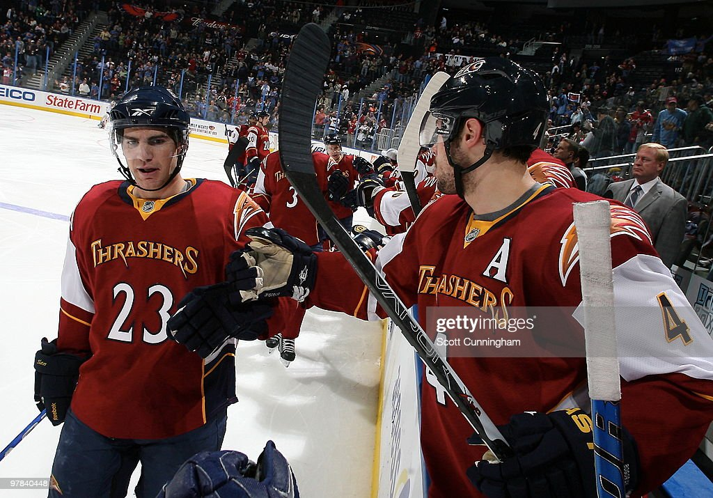 Jim Slater #23 of the Atlanta Thrashers is congratulated by teammates after scoring against the Ottawa Senators at Philips Arena on March 18, 2010 in Atlanta, Georgia.