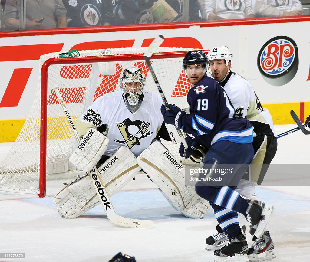 Jim Slater #19 of the Winnipeg Jets battles for position against Brooks Orpik #44 of the Pittsburgh Penguins as goaltender Marc-Andre Fleury #29 gets set during second period action at the MTS Centre on February 15, 2013 in Winnipeg, Manitoba, Canada.