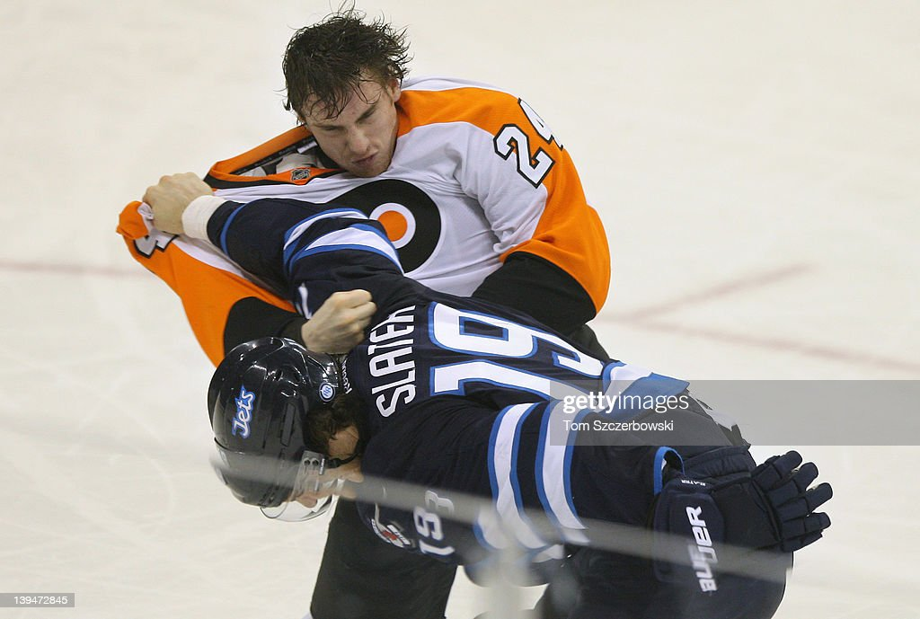 Jim Slater #19 of the Winnipeg Jets fights with Matt Read #24 of the Philadelphia Flyers during their NHL game at MTS Centre on February 21, 2012 in Winnipeg, Manitoba, Canada.