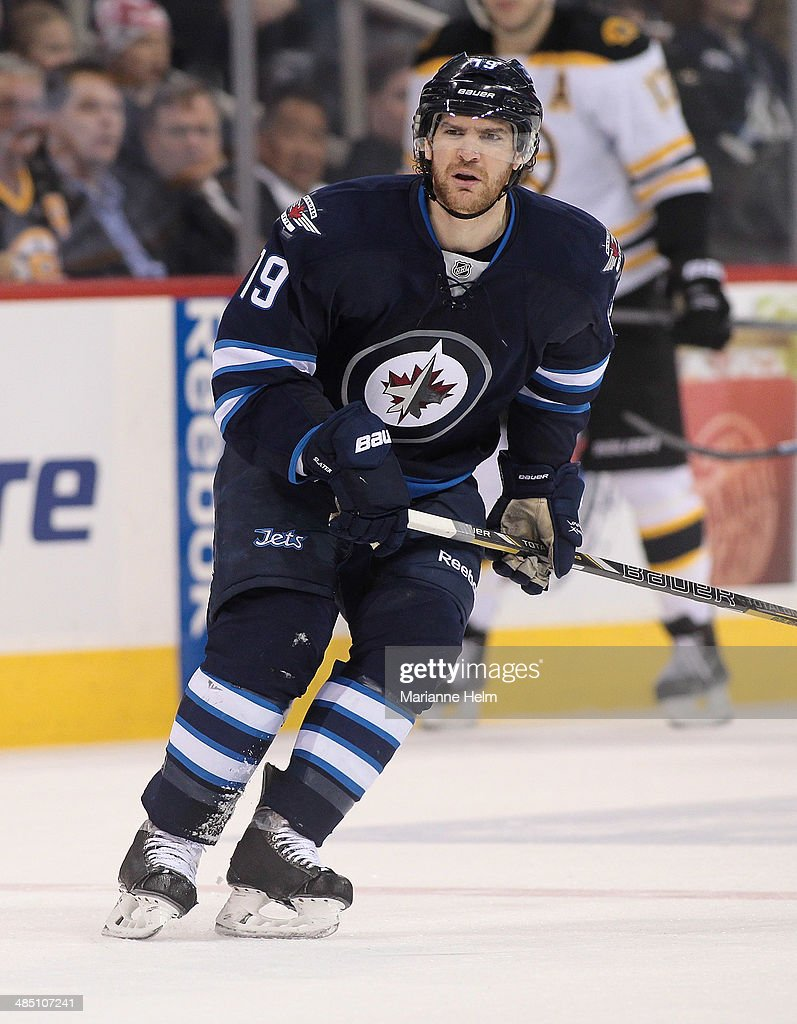Jim Slater #19 of the Winnipeg Jets skates down the ice during the second period of the NHL game against the Boston Bruins at the MTS Centre on April 10, 2014 in Winnipeg, Manitoba, Canada.