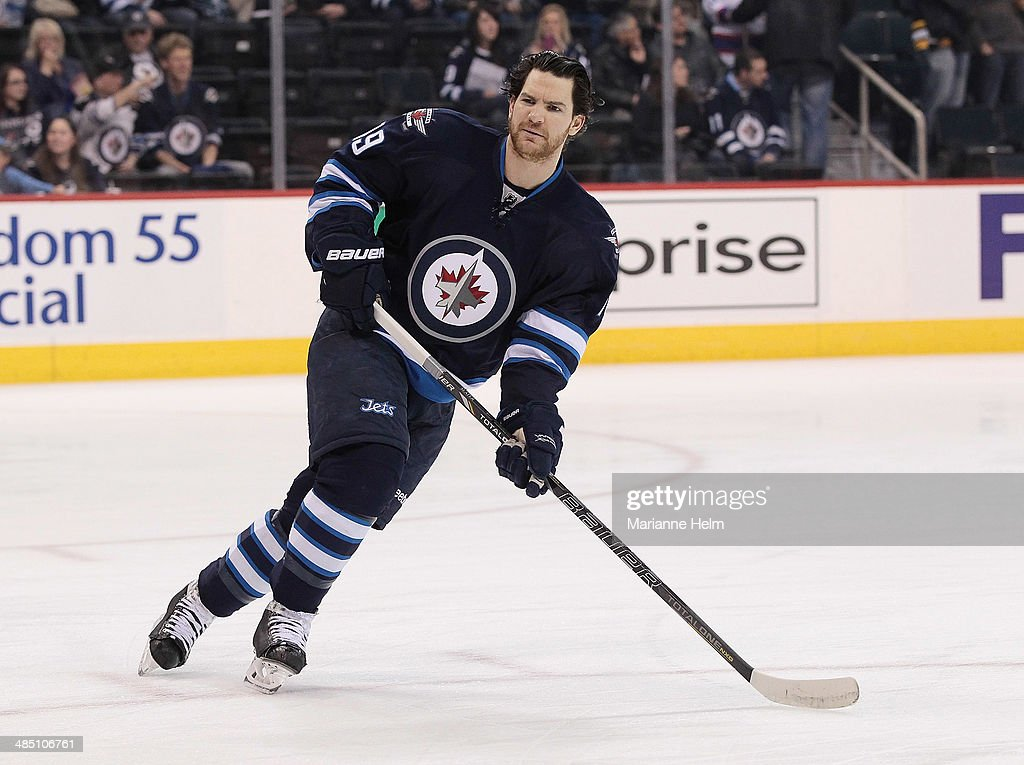 Jim Slater #19 of the Winnipeg Jets skates down the ice during warmup before an NHL game against the Boston Bruins at the MTS Centre on April 10, 2014 in Winnipeg, Manitoba, Canada.
