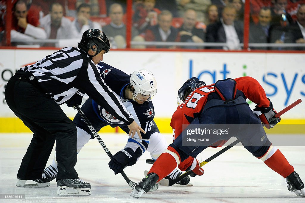 Jim Slater #19 of the Winnipeg Jets takes a face off against <a gi-track='captionPersonalityLinkClicked' href=/galleries/search?phrase=Mathieu+Perreault&family=editorial&specificpeople=776813 ng-click='$event.stopPropagation()'>Mathieu Perreault</a> #85 of the Washington Capitals at the Verizon Center on February 9, 2012 in Washington, DC.