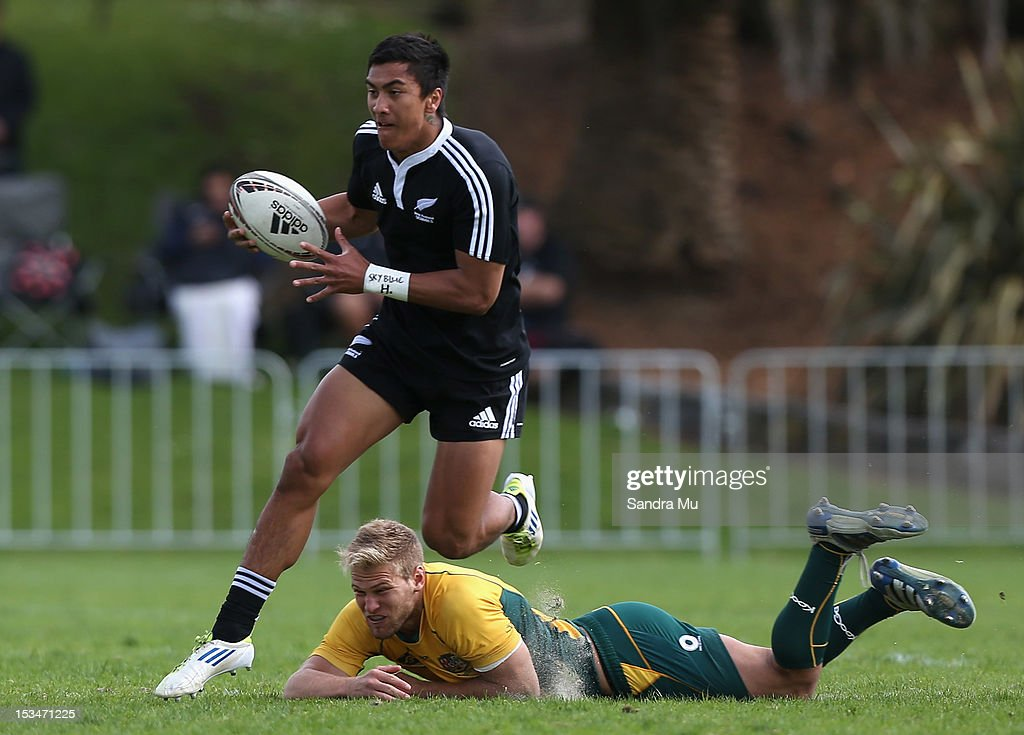 Jim Stewart of Australia attempts to tackle Trinity Spooner-Neera of New Zealand during the Test between New Zealand Schools and Australia Schools at Auckland Grammar on October 6, 2012 in Auckland, New Zealand.