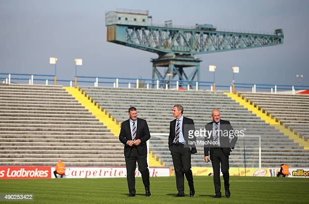 Jim Stewart Rangers goalkeeping coach David Weir assistant coach and Rangers manager Mark Warburton walk on the pitch before the Scottish...