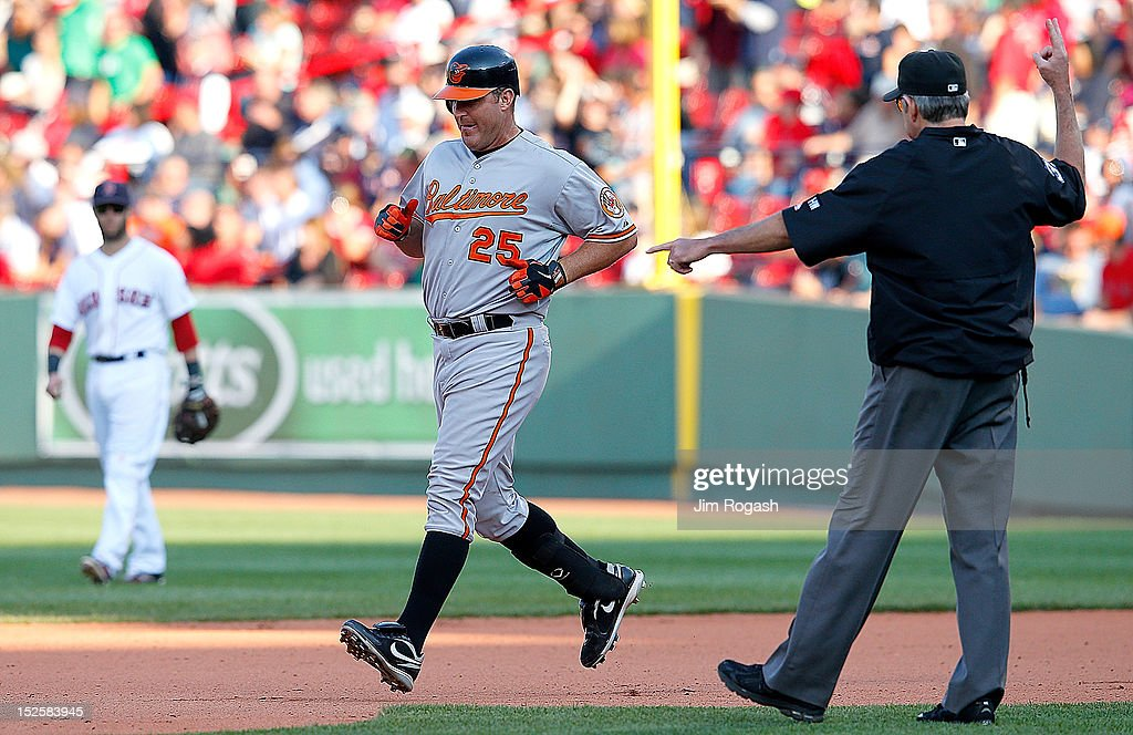 <a gi-track='captionPersonalityLinkClicked' href=/galleries/search?phrase=Jim+Thome&family=editorial&specificpeople=202878 ng-click='$event.stopPropagation()'>Jim Thome</a> #25 of the Baltimore Orioles knocks in the winning run on a ground-rule double in the 12th inning against the Boston Red Sox for a 9-6 win at Fenway Park on September 22, 2012 in Boston, Massachusetts.