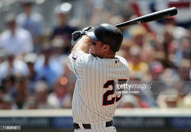 Jim Thome of the Minnesota Twins hits a solo home run against the Milwaukee Brewers in the second inning on July 3 2011 at Target Field in...