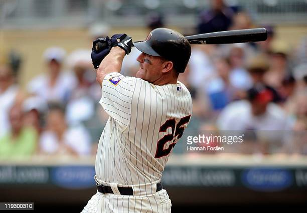 Jim Thome of the Minnesota Twins hits a threerun home run against the Kansas City Royals in the sixth inning on July 17 2011 at Target Field in...