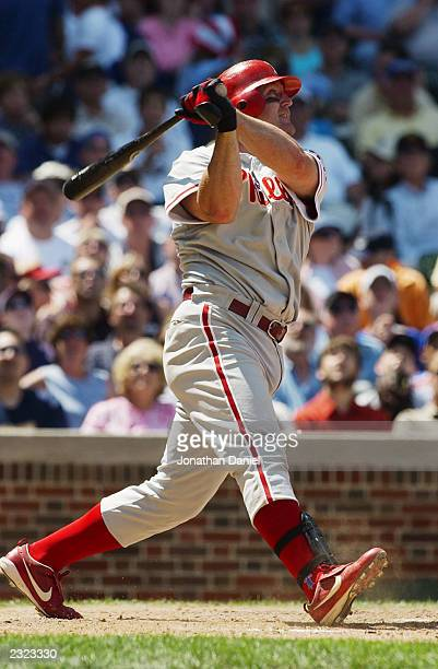 Jim Thome of the Philadelphia Phillies eyes his batted ball against the Chicago Cubs during the game on July 24 2003 at Wrigley Field in Chicago...