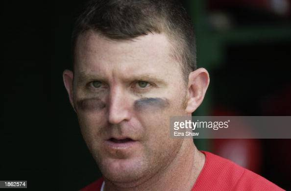 Jim Thome of the Philadelphia Phillies looks on from the dugout against the New York Yankees in a spring training game on February 28 2003 at Jack...
