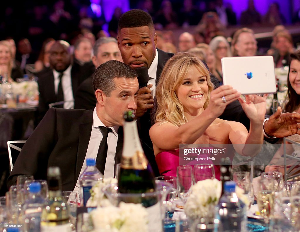 Jim Toth host Michael Strahan and actress Reese Witherspoon pose for selfies during the 20th annual Critics' Choice Movie Awards at the Hollywood...