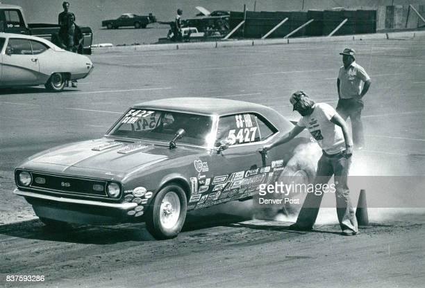 Jim Weakland revs Camaro's engine in preparation for his turn at the starting line Partner Jerry Ernst checks door Credit Denver Post