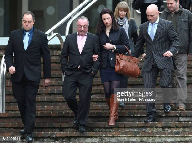 Jim Wilkinson father of Natalie Esack is accompanied by family members as he leaves Maidstone Crown Court in Kent after Ivan Esack was found guilty...