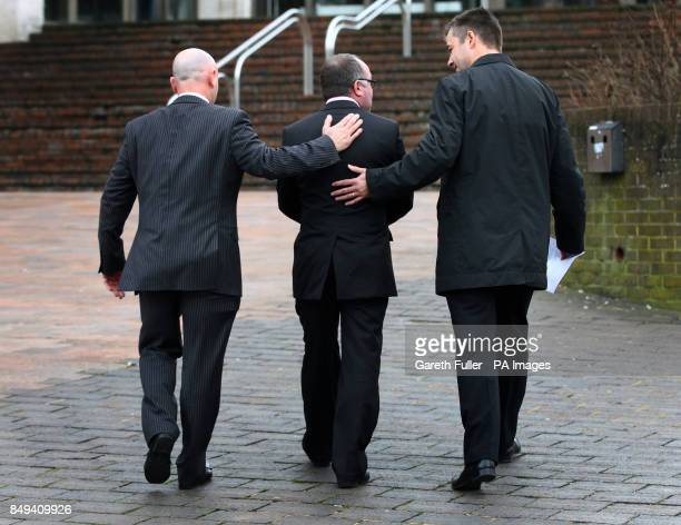 Jim Wilkinson father of Natalie Esack is comforted by police officers after talking to reporters at Maidstone Crown Court in Kent after Ivan Esack...