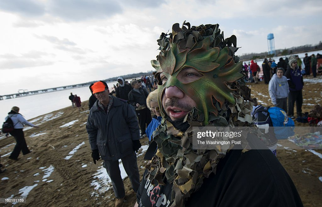 Jim Wilmering of Halethorpe, MD wore a kilt with his Green Men mask for the 17th Annual MSP Polar Bear Plunge at Sandy Point State Park on Saturday, January 26, 2013.