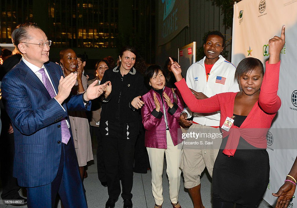 <a gi-track='captionPersonalityLinkClicked' href=/galleries/search?phrase=Jim+Yong+Kim&family=editorial&specificpeople=2302483 ng-click='$event.stopPropagation()'>Jim Yong Kim</a> and Naoko Ishii rap along with Kenya based rap group TS1 at Connect4Climate: Right Here, Right Now at The World Bank on March 1, 2013 in Washington, DC.
